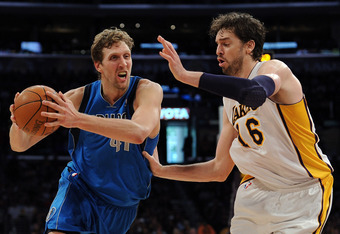 LOS ANGELES, CA - APRIL 15:  Dirk Nowitzki #41 of the Dallas Mavericks drives on Pau Gasol #16 of the Los Angeles Lakers during a 112-108 Laker overtime win at Staples Center on April 15, 2012 in Los Angeles, California.  NOTE TO USER: User expressly ackn