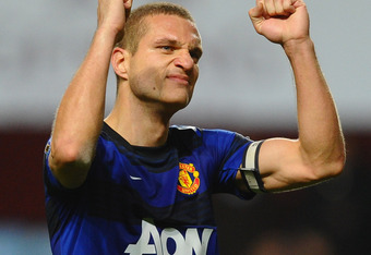 BIRMINGHAM, ENGLAND - DECEMBER 03: Nemanja Vidic of Manchester United celebrates victory at the final whistle during the Barclays Premier League match between Aston Villa and Manchester United at Villa Park on December 3, 2011 in Birmingham, England.  (Ph