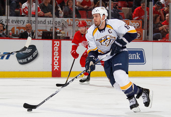 DETROIT, MI - APRIL 17:  Shea Weber #6 of the Nashville Predators brings the puck up ice in front of Danny Cleary #11 of the Detroit Red Wings during Game Four of the Western Conference Quarterfinals during the 2012 NHL Stanley Cup Playoffs at Joe Louis A