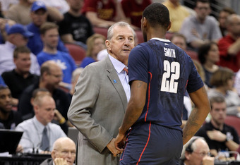 LOUISVILLE, KY - MARCH 15:  Head coach Jim Calhoun of the Connecticut Huskies talks with Roscoe Smith #22 in the first half against the Iowa State Cyclones during the second round of the 2012 NCAA Men's Basketball Tournament at KFC YUM! Center on March 15
