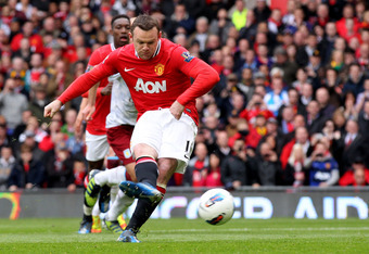 MANCHESTER, ENGLAND - APRIL 15:   Wayne Rooney of Manchester United scores the opening goal from a penalty during the Barclays Premier League match between Manchester United and Aston Villa at Old Trafford on April 15, 2012 in Manchester, England. (Photo