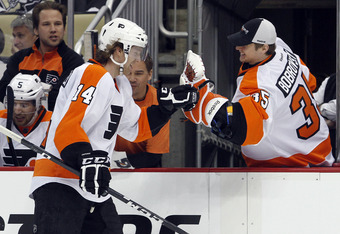 PITTSBURGH, PA - APRIL 13:  Sean Couturier #14 of the Philadelphia Flyers celebrates his hat trick goal against the Pittsburgh Penguins in Game Two of the Eastern Conference Quarterfinals during the 2012 NHL Stanley Cup Playoffs at Consol Energy Center on