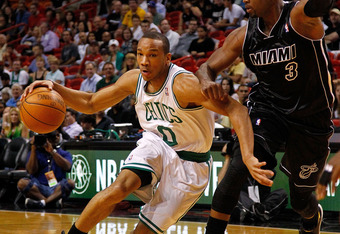 MIAMI, FL - APRIL 10: Avery Bradley #0 of the Boston Celtics drives on Dwyane Wade #3 of the Miami Heat during a game  at American Airlines Arena on April 10, 2012 in Miami, Florida. NOTE TO USER: User expressly acknowledges and agrees that, by downloadin