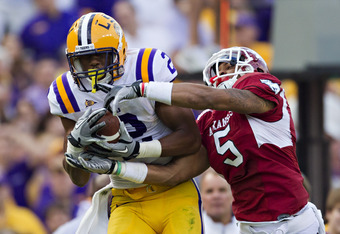 BATON ROUGE, LA - NOVEMBER 25:   Rueben Randle #2 of the LSU Tigers catches a pass over Tramain Thomas #5 of the Arkansas Razorbacks at Tiger Stadium on November 25, 2011 in Baton Rouge, Louisiana.  The Tigers defeated the Razorbacks 41 to 17.  (Photo by
