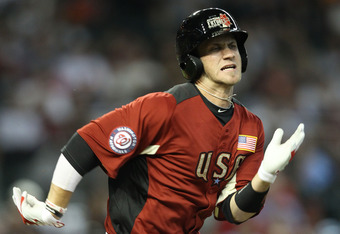 PHOENIX, AZ - JULY 10:  U.S. Futures All-Star Bryce Harper #34 of the Washington Nationals runs to first base after grounding out in the third inning of the 2011 XM All-Star Futures Game at Chase Field on July 10, 2011 in Phoenix, Arizona.  (Photo by Chri