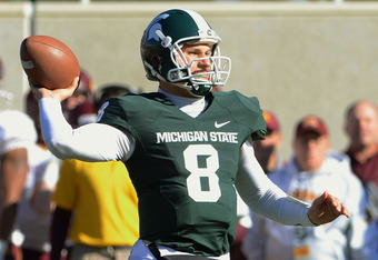 EAST LANSING, MI - NOVEMBER 05:  Kirk Cousins #8 of the Michigan State Spartans throws a pass in the fourth quarter of the game against the Minnesota Golden Gophers at Spartan Stadium on November 5, 2011 in East Lansing, Michigan. The Spartans defeated th