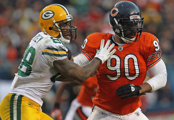 CHICAGO, IL - SEPTEMBER 25:  Julius Peppers #90 of the Chicago Bears rushes against Jermichael Finley #88 of the Green Bay Packers at Soldier Field on September 25, 2011 in Chicago, Illinois. The Packers defeated the Bears 27-17.  (Photo by Jonathan Danie
