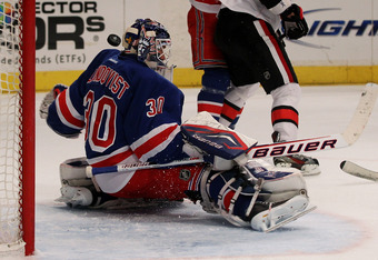 NEW YORK, NY - APRIL 26:  A shot flies wide past Henrik Lundqvist #30 of the New York Rangers in Game Seven of the Eastern Conference Quarterfinals against the Ottawa Senators during the 2012 NHL Stanley Cup Playoffs at Madison Square Garden on April 26,