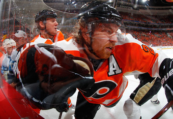 PHILADELPHIA, PA - APRIL 22:  Claude Giroux #28 of the Philadelphia Flyers is checked into the glass by the Pittsburgh Penguins in Game Six of the Eastern Conference Quarterfinals during the 2012 NHL Stanley Cup Playoffs at Wells Fargo Center on April 22,