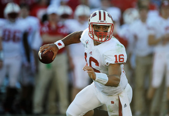 PASADENA, CA - JANUARY 02:  Quarterback Russell Wilson #16 of the Wisconsin Badgers looks to pass the ball in the first half against the Oregon Ducks at the 98th Rose Bowl Game on January 2, 2012 in Pasadena, California.  (Photo by Harry How/Getty Images)