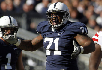 STATE COLLEGE, PA - NOVEMBER 12:  Devon Still #71 of the Penn State Nittany Lions celebrates after sacking Taylor Martinez #3 (not pictured) of the Nebraska Cornhuskers during the game on November 12, 2011 at Beaver Stadium in State College, Pennsylvania.