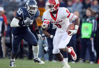 EAST HARTFORD, CT - NOVEMBER 26: Mohamed Sanu #6 of the Rutgers Scarlet Knights carries the ball as Yawin Smallwood #33 of the Connecticut Huskies defends on November 26, 2011 at Rentschler Field in East Hartford, Connecticut. The Connecticut Huskies defe