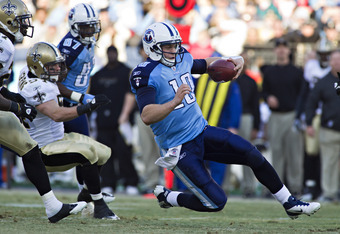 NASHVILLE, TN - DECEMBER 11:   Quarterback Jake Locker #10 of the Tennessee Titans slides to end a run against the New Orleans Saints at LP Field on December 11, 2011 in Nashville, Tennessee.  The Saints defeated the Titans 22-17.  (Photo by Wesley Hitt/G