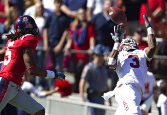 OXFORD,  MS - OCTOBER 22:   Joe Adams #3 of the Arkansas Razorbacks catches a pass at the goal line over Frank Crawford #5 of the Ole Miss Rebels at Vaught-Hemingway Stadium on October 22, 2011 in Oxford, Mississippi.  The Razorbacks defeated the Rebels 2