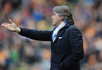 WOLVERHAMPTON, ENGLAND - APRIL 22:  Roberto Mancini of Manchester United looks on during the Barclays Premier League match between Wolverhampton Wanderers and Manchester City at Molineux on April 22, 2012 in Wolverhampton, England.  (Photo by Jamie McDona