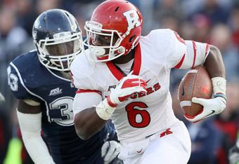 EAST HARTFORD, CT - NOVEMBER 26:  Mohamed Sanu #6 of the Rutgers Scarlet Knights carries the ball as Yawin Smallwood #33 of the Connecticut Huskies defends on November 26, 2011 at Rentschler Field in East Hartford, Connecticut. The Connecticut Huskies def