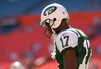 MIAMI GARDENS, FL - JANUARY 01:   Plaxico Burress #17 of the New York Jets looks on during a game against the Miami Dolphins at Sun Life Stadium on January 1, 2012 in Miami Gardens, Florida.  (Photo by Mike Ehrmann/Getty Images)