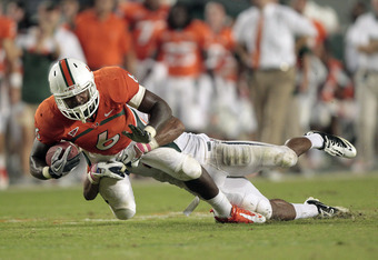 MIAMI, FL - OCTOBER 27: Rodney McLeod #4 of the Virginia Cavaliers tackles Lamar Miller #6 of the Miami Hurricanes as he runs with the ball on October 27, 2011 at Sun Life Stadium in Miami, Florida. Virginia defeated Miami 28-21. (Photo by Joel Auerbach/G