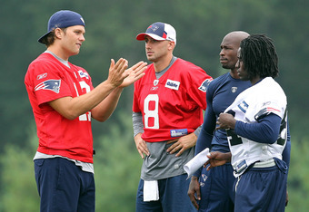 FOXBOROUGH, MA  - JULY 29:  Tom Brady #12, Chad Ochocinco, Brian Hoyer #8 and Deion Branch #84 of the New England Patriots watch the action during training camp at Gillette Stadium on July 29, 2011 in Foxborough, Massachusetts.  (Photo by Jim Rogash/Getty