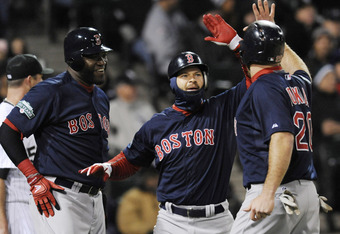 CHICAGO, IL - APRIL 27: (L-R) David Ortiz #34 of the Boston Red Sox, Cody Ross #7 and Kevin Youkilis #20 celebrate after scoring in the sixth inning against the Chicago White Sox on April 27, 2012 at U.S. Cellular Field in Chicago, Illinois.  (Photo by Da