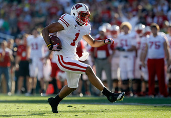 PASADENA, CA - JANUARY 02:  Wide receiver Nick Toon #1 of the Wisconsin Badgers runs after a catch in the first half against the Oregon Ducks at the 98th Rose Bowl Game on January 2, 2012 in Pasadena, California.  (Photo by Jeff Gross/Getty Images)