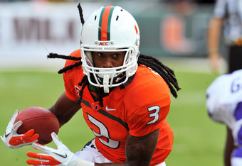 MIAMI GARDENS, FL - SEPTEMBER 24:  Wide receiver Travis Benjamin #3 of the Miami Hurricanes returns a kick against the Kansas State University Wildcats September 24, 2011 at Sun Life Stadium in Miami Gardens, Florida.  (Photo by Al Messerschmidt/Getty Ima