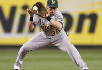 SEATTLE - AUGUST 01:  Shortstop Eric Sogard #36 of the Oakland Athletics fields a tricky hop ground ball by Franklin Gutierrez of the Seattle Mariners at Safeco Field on August 1, 2011 in Seattle, Washington. (Photo by Otto Greule Jr/Getty Images)