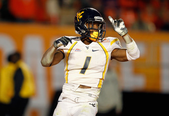 MIAMI GARDENS, FL - JANUARY 04:  Tavon Austin #1 of the West Virginia Mountaineers celebrates after he scored an 8-yard rushing touchdown in the first quarter against the Clemson Tigers during the Discover Orange Bowl at Sun Life Stadium on January 4, 201