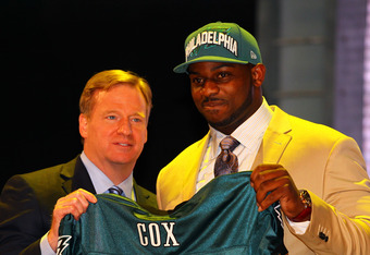 NEW YORK, NY - APRIL 26:  Fletcher Cox of Mississippi State holds up a jersey as he stands on stage with NFL Commissioner Roger Goodell after he was selected #12 overall by the Seattle Seahawks in the first round of the 2012 NFL Draft at Radio City Music