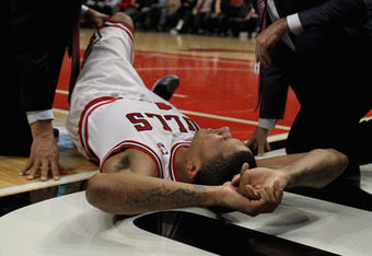 CHICAGO, IL - APRIL 28:  Derrick Rose #1 of the Chicago Bulls is examined after suffering an injury against the Philadelphia 76ers in Game One of the Eastern Conference Quarterfinals during the 2012 NBA Playoffs at the United Center on April 28, 2012 in C