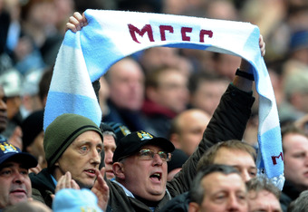 MANCHESTER, ENGLAND - JANUARY 08:  A Manchester City fan shows his support during the FA Cup Third Round match between Manchester City and Manchester United at the Etihad Stadium on January 8, 2012 in Manchester, England.  (Photo by Laurence Griffiths/Get