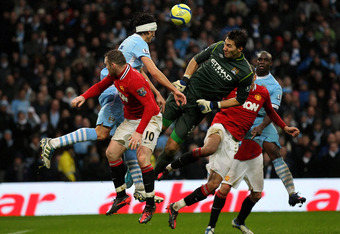 MANCHESTER, ENGLAND - JANUARY 08:   Costel Pantilimon of Manchester City goes up for a header during the FA Cup Third Round match between Manchester City and Manchester United at the Etihad Stadium on January 8, 2012 in Manchester, England. (Photo by Alex