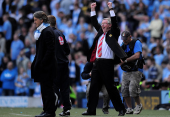 MANCHESTER, ENGLAND - APRIL 17:  Manchester United Manager Sir Alex Ferguson celebrates as Manchester City Manager Roberto Mancini looks on during the Barclays Premier League match between Manchester City and Manchester United at the City of Manchester St