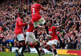 MANCHESTER, ENGLAND - APRIL 22:  Nani of Manchester United celebrates scoring his team's third goal with his team mates during the Barclays Premier League match between Manchester United and Everton at Old Trafford on April 22, 2012 in Manchester, England