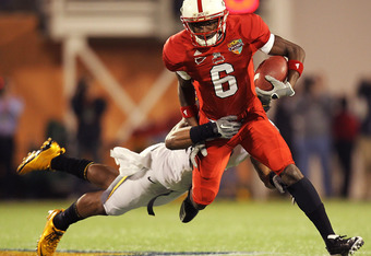 ORLANDO, FL - DECEMBER 28: T.J. Graham #6 of the North Carolina State Wolfpack makes a catch during the Champs Sports Bowl against the West Virginia Mountineers at Florida Citrus Bowl Stadium on December 28, 2010 in Orlando, Florida.  (Photo by Mike Ehrma