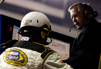 RICHMOND, VA - APRIL 28:  Crew chief Bob Osborne (R) argues with an official after Carl Edwards (not pictured), driver of the #99 Eco-Boost Ford, was black flagged for an early restart during the NASCAR Sprint Cup Series Capital City 400 at Richmond Inter