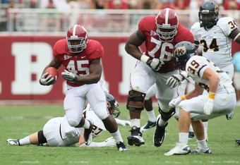 TUSCALOOSA, AL - SEPTEMBER 3:  Runningback Jalston Fowler #45 of the Alabama Crimson Tide follows the block of lineman D. J. Fluker #76 during the fourth quarter past safety Luke Wollet #39 of the Kent State Golden Flashes on September 3, 2011 at Bryant D