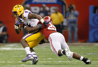 NEW ORLEANS, LA - JANUARY 009: Alfred Blue #4 of the Louisiana State University Tigers gets tackled by C.J. Mosley #32 of the Alabama Crimson Tide during the 2012 Allstate BCS National Championship Game at Mercedes-Benz Superdome on January 9, 2012 in New