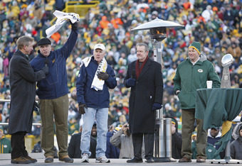 GREEN BAY, WI - FEBRUARY 08: Green Bay Packers head coach Mike McCarthy, GM Ted Thompson, and Team president Mark Murphy talk with Packer radio announcers Wayne Larrivee and Larry McCarren during the Packers victory celebration at Lambeau Field  on Februa