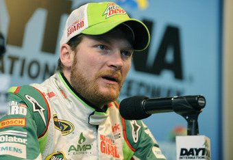 DAYTONA BEACH, FL - JANUARY 12:  Dale Earnhardt Jr., driver of the #88 Diet Mountain Dew Chevrolet, speaks to the media during Daytona Preseason Thunder at Daytona International Speedway on January 12, 2012 in Daytona Beach, Florida.  (Photo by Jared C. T