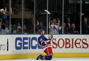 NEW YORK, NY - APRIL 28:  Chris Kreider #20 of the New York Rangers celebrates his third period goal in Game One of the Eastern Conference Semifinals against the Washington Capitals during the 2012 NHL Stanley Cup Playoffs at Madison Square Garden on Apri