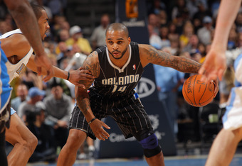 DENVER, CO - APRIL 22:  Jameer Nelson #14 of the Orlando Magic controls the ball against the Denver Nuggets at Pepsi Center on April 22, 2012 in Denver, Colorado. The Nuggets defeated the Magic 101-74. NOTE TO USER: User expressly acknowledges and agrees
