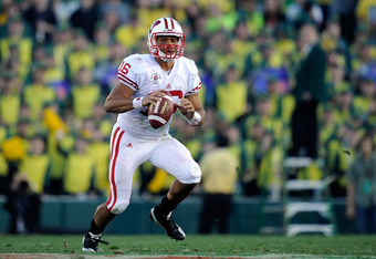 PASADENA, CA - JANUARY 02:  Quarterback Russell Wilson #16 of the Wisconsin Badgers throws the ball against the Oregon Ducks at the 98th Rose Bowl Game on January 2, 2012 in Pasadena, California.  (Photo by Kevork Djansezian/Getty Images)