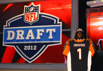 NEW YORK, NY - APRIL 26:  Dre Kirkpatrick of Alabama holds up a jersey as he stands on stage after he was selected #17 overall by the Cincinnati Bengals in the first round of during the 2012 NFL Draft at Radio City Music Hall on April 26, 2012 in New York