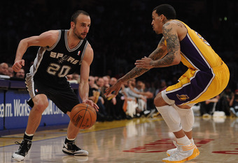 LOS ANGELES, CA - APRIL 17:  Manu Ginobili #20 of the San Antonio Spurs dribbles on Matt Barnes #9 of the Los Angeles Lakers at Staples Center on April 17, 2012 in Los Angeles, California.  NOTE TO USER: User expressly acknowledges and agrees that, by dow
