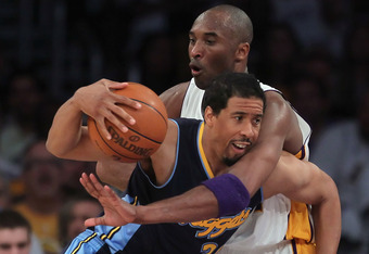 LOS ANGELES, CA - APRIL 29:  Andre Miller #24 of the Denver Nuggets is fouled by Kobe Bryant #24 of the Los Angeles Lakers during the first half in Game One of the Western Conference Quarterfinals in the 2012 NBA Playoffs on April 29, 2012 at Staples Cent