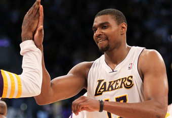 LOS ANGELES, CA - MARCH 11: Andrew Bynum #17 of the Los Angeles Lakers celebrates after the game with the Boston Celtics at Staples Center on March 11, 2012 in Los Angeles, California.  The Lakers won 97-94.  NOTE TO USER: User expressly acknowledges and