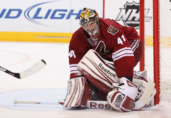 GLENDALE, AZ - APRIL 27:  Goaltender Mike Smith #41 of the Phoenix Coyotes covers the puck in Game One of the Western Conference Semifinals against the Nashville Predators during the 2012 NHL Stanley Cup Playoffs at Jobing.com Arena on April 27, 2012 in G
