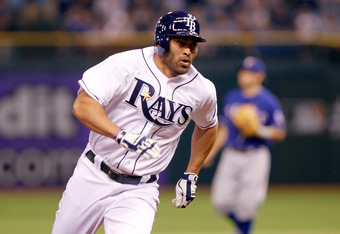 ST PETERSBURG, FL - OCTOBER 03:  Johnny Damon #22 of the Tampa Bay Rays heads to third base in the seventh inning on a Casey Kotchman #11 single before scoring the Rays second run later in the inning against the Texas Rangers in Game Three of the American