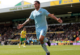 NORWICH, ENGLAND - APRIL 14:  Carlos Tevez of Manchester City celebrates scoring his team's fifth goal to complete his hat trick during the Barclays Premier League match between Norwich City and Manchester City at Carrow Road on April 14, 2012 in Norwich,